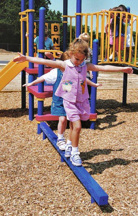 Kids playing on a balance beam