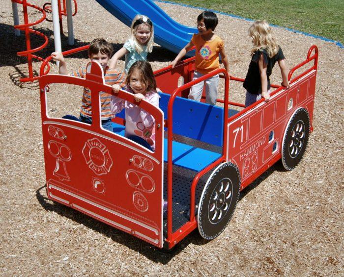 school children on a playgournd firetruck